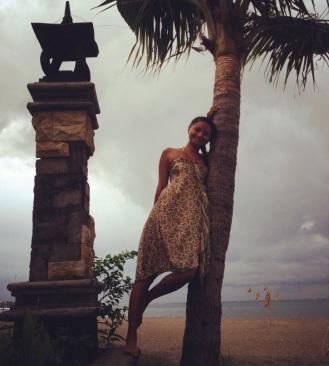 Balancing on a palm tree