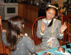 Getting a makeover from my little sister Fania.