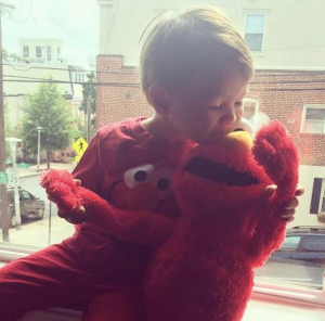 We dressed him up as Elmo and he loved seeing himself in the mirror.