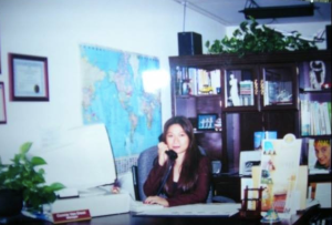 My mom at her travel agency, many years ago.