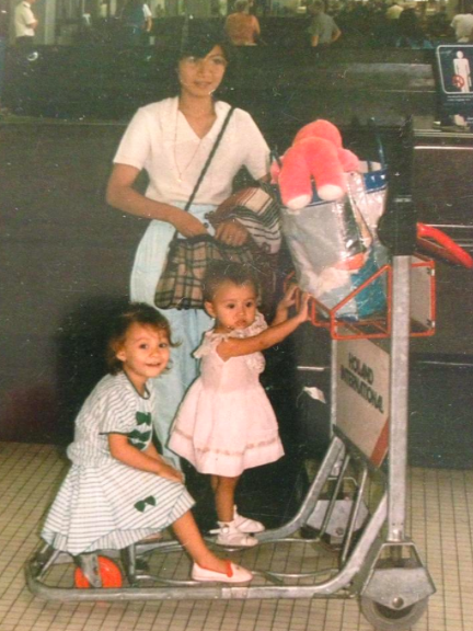 Our big move to America! Yes that is me the little one holding on to the trolley at 3-years old.